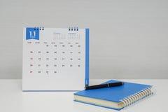 会议的概念与11月日历和笔记本的 免版税库存照片