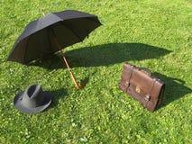 伞、袋子和帽子 免版税库存图片