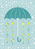 伞在与太阳和风车的雨中 免版税图库摄影