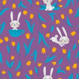 传染媒介无缝的样式用兔子和郁金香在紫罗兰 皇族释放例证