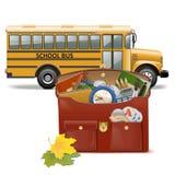 传染媒介书包和公共汽车 库存图片