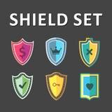 传染媒介五颜六色的盾 免版税图库摄影