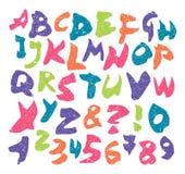 传染媒介五颜六色的难看的东西字体和数字 免版税库存图片