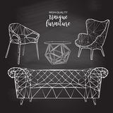 传染媒介剪影多角形椅子沙发咖啡桌 免版税库存图片