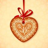 传染媒介在红色丝带的姜饼心脏 库存照片