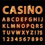 传染媒介橙色霓虹灯信件字体展示赌博娱乐场或剧院 库存照片