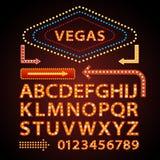 传染媒介橙色霓虹灯信件字体展示维加斯光标志剧院 免版税图库摄影