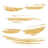 传染媒介金被设置的油漆污迹 金子在白色背景的闪烁元素 金发光的油漆冲程 抽象金子闪烁尘土 图库摄影