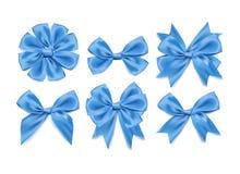 传染媒介3d现实丝带塑造了被设置的蓝色弓 背景 免版税库存照片