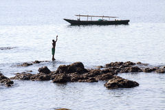 传染性的星期日 (Lamalera,印度尼西亚) 免版税图库摄影