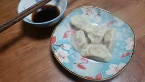 传统中国食物在特别地做的盘安置 库存照片