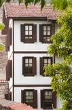 传统之家无背长椅 库存照片