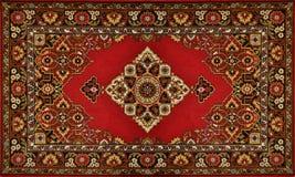传统地毯华丽红色的纹理 库存图片
