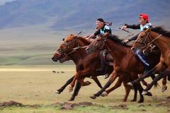 传统马国家游牧人的骑马 免版税库存图片