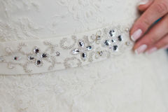 传送带和礼服在新娘 免版税库存照片