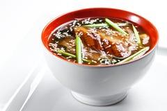 传统日本大酱汤用在白色背景隔绝的鳗鱼 图库摄影