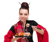 传统礼服的妇女用东部食物 图库摄影