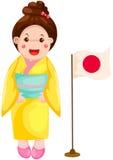 传统礼服的逗人喜爱的日本女孩 免版税图库摄影