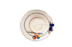 一个传统罗马尼亚帽子的上面由秸杆制成,隔绝反对白色背景 免版税库存照片