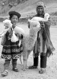 传统衣物的未认出的孩子 库存图片