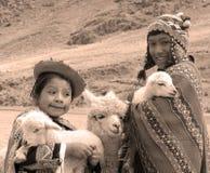 传统衣物的未认出的孩子 免版税图库摄影