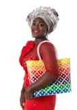 传统衣物的非洲妇女有大手提袋的 查出 免版税库存照片