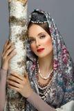 传统衣裳的美丽的俄国女孩 库存图片