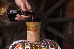 传统酒倾吐 图库摄影