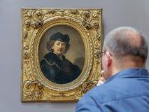 伦布兰特-佩带无边女帽和金链子的自画象 库存照片