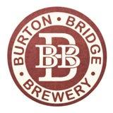 伦敦,英国- 2018年2月04日:伯顿桥梁啤酒厂在白色隔绝的beermat沿海航船 库存照片