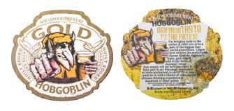 伦敦,英国- 2018年3月01日:在白色隔绝的Hopgoblin金原始的beermat沿海航船 免版税库存照片