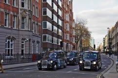 伦敦,英国- 01日DEC 2016年-典型的伦敦出租汽车 图库摄影
