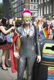 伦敦,英国- 6月29日:摆在为pi的同性恋自豪日的参加者 免版税图库摄影