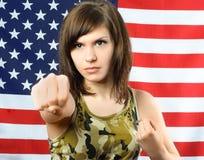 伪装穿戴的妇女年轻人 免版税库存照片