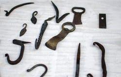 伪造的铁片断在市场的待售 免版税库存照片