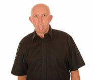 伸出他的舌头的人 免版税库存照片