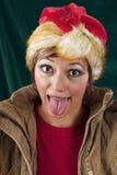 伸出舌头的滑稽的圣诞老人 免版税库存照片