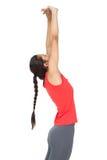 伸手的一个运动的少妇的侧视图 库存图片