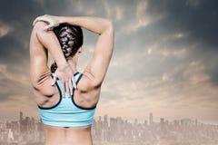 伸手的妇女背面图的综合图象 免版税图库摄影