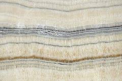 类似玛瑙的条纹大理石背景 库存照片