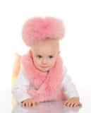 位于在空白背景的桃红色毛皮的逗人喜爱的婴孩 免版税库存照片
