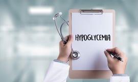 低血糖症打印的诊断医疗概念 库存照片
