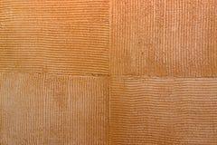 围住纹理石灰华橙色棕色方形的油漆背景 免版税库存照片