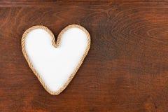 系住以与一个地方的心脏的形式您的文本的,说谎木表面的 图库摄影