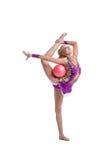 体操专业运动员执行与球 免版税图库摄影