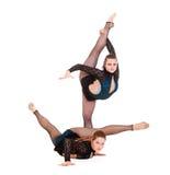 体操节奏性显示的妇女 免版税库存图片