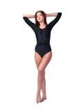 黑体操衣服的美丽的女孩 免版税库存照片