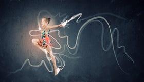 体操运动员女孩 免版税库存照片