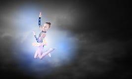 体操运动员女孩 免版税库存图片
