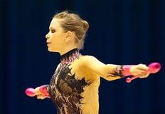体操运动员执行在Irina Deleanu桔子战利品 免版税库存图片